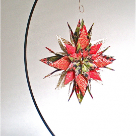 Origami Inspired Origami Inspired Holiday Floral Paper Star on an ornament stand